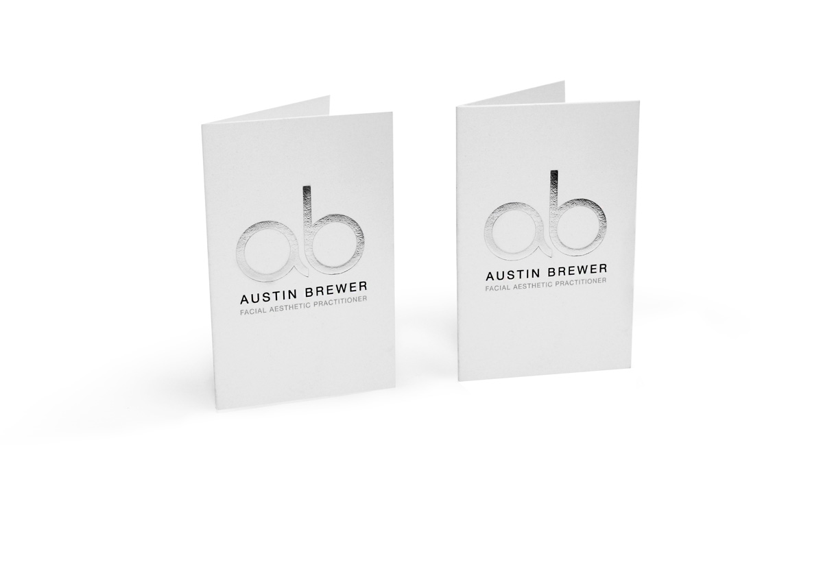 folded business card with metallic logo effect
